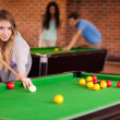 Student woman playing snooker — Stock Photo