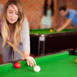 Portrait of a cute woman playing snooker — Stock Photo #11194252