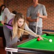 Portrait of young friends playing snooker — Stock Photo