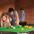 Couple playing snooker — Stock Photo #11194268