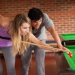 Young couple playing snooker — Stock Photo #11194269