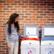 Portrait of a young woman recycling — Stock Photo