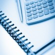 Angled notebook with pencil and pocket calculator — Stock Photo #11194438