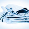 Newspapers and black glasses — Stock Photo #11194454