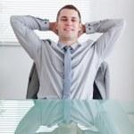 Businessman sitting back — Stock Photo
