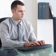 Businessman typing on his computer — Stock Photo