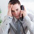 Depressed businessman on the phone — Stock Photo #11195120