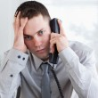 Businessman getting bad news on the phone — Stock Photo #11195122