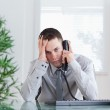 Businessman getting disappointing news on the phone — Stock Photo #11195123