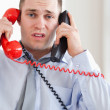Close up of businessman troubled by the telephone — Stock Photo #11195313