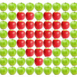 Green wet apples with red apples in between - Stok fotoğraf