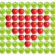 Green wet apples with red apples in between - Stockfoto