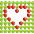 Green wet apples with red apples shaping heart in between — Stock Photo #11195834
