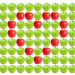 Green wet apples with red apples in heart shape in between — Stock Photo