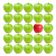 Green wet apples surrounding red apple — Stock Photo