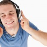 Happy man listening to music — Stock Photo #11196569