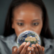 Beautiful woman holding the Earth — Stock Photo