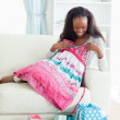 Woman on couch with new dress — Stock Photo