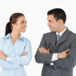 Business partners with arms folded looking at each other — Stock Photo