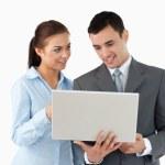 Business partners using laptop — Stock Photo