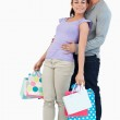 Young male holding his girlfriend with her shopping — Stock Photo #11199848