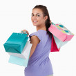 Rear view of young female with shopping bags — Stock Photo