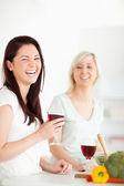 Cheering Women cooking dinner — Stock Photo