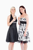 Smiling women in beautiful dresses with champaign — Stock Photo