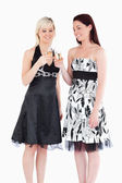 Smiling women in beautiful dresses toasting with champaign — Stock Photo