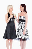 Cheerful women in beautiful dresses toasting with champaign — Stock Photo