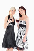 Smiling well-dressed women drinking red wine — Stock Photo