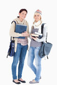 Two students with books prepared for winter — Stock Photo