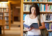 Smiling student reading a book — Stock Photo