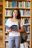 Portrait of a student holding a book — Stock Photo