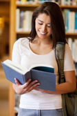 Portrait of a cute student reading a book — Stock Photo