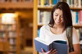Cute student reading a book — Stock Photo