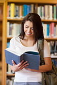 Portrait of a beautiful student reading a book — Stock Photo