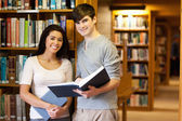 Young students with a book — Stock Photo