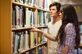 Students choosing a book — Stock Photo