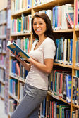 Cute student holding a book — Stock Photo