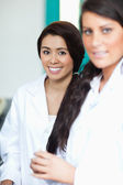 Portrait of female scientists posing — Stock Photo