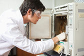 Male scientist using a laboratory chamber furnace — Stock Photo