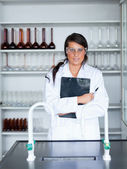Portrait of a female scientist holding a clipboard — Stock Photo