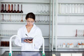 Student in science writing on a clipboard — Stock Photo
