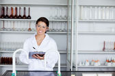 Smiling student in science writing on a clipboard — Stock Photo