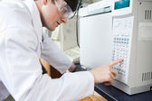 Science student using a laboratory chamber furnace in a laborato — Stock Photo