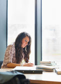 Portrait of a serious student writing — Stock Photo