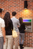 Portrait of queuing to withdraw cash — Stock Photo