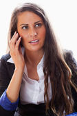 Portrait of a surprised woman on the phone — Stock Photo