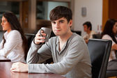 Young man having a coffee — Stock Photo